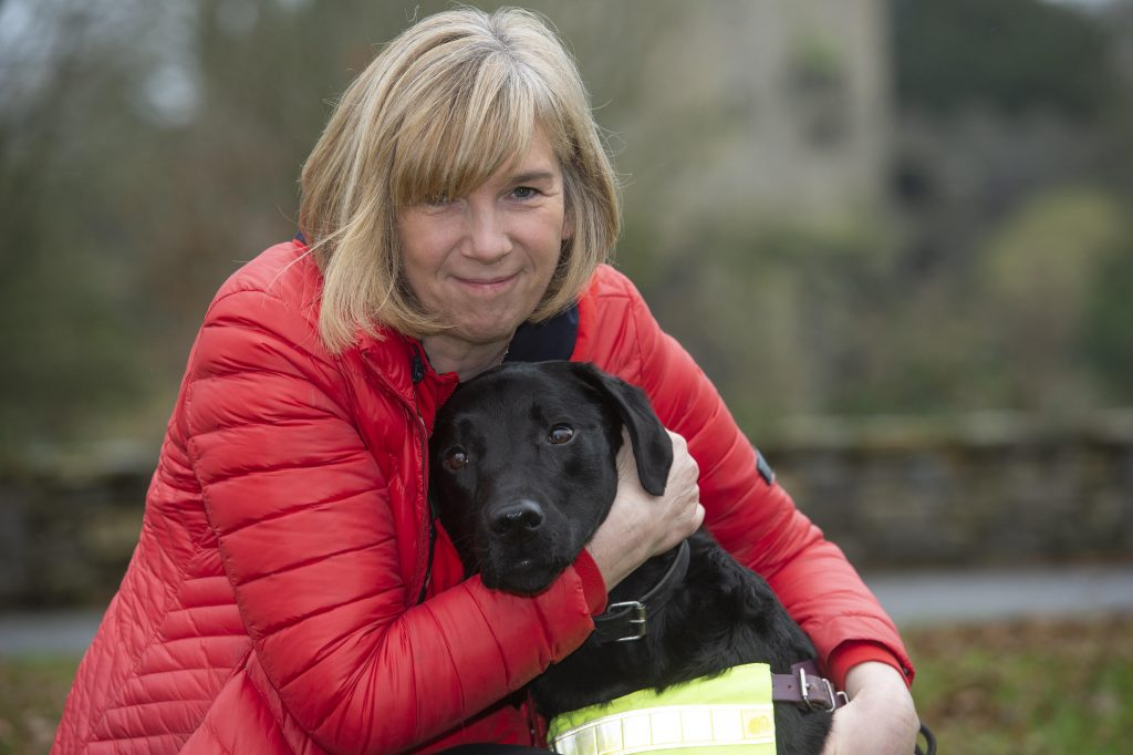 April 2020 Cork Person of the Month winner community activist Kate Durrant picture with her dog Hugo at Blarney castle
