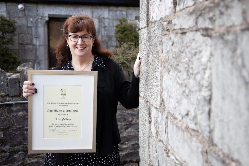 Picture of Ann-Marie O'Sullivan with PRII award certificate.