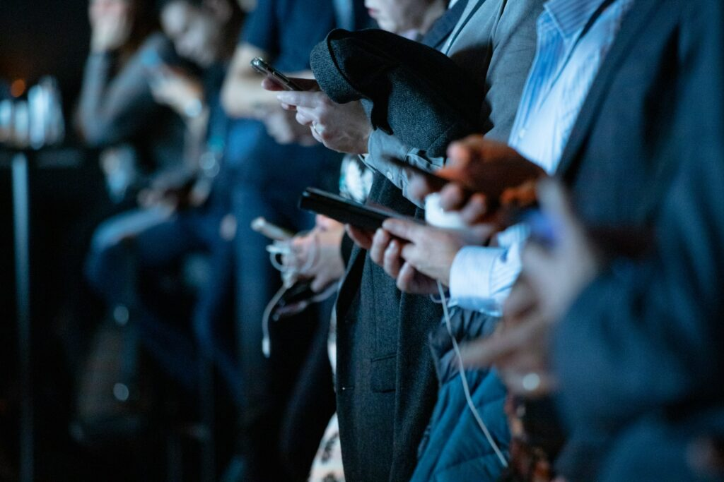 Members of the media holding smartphones